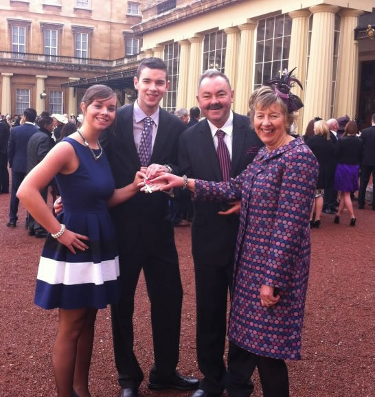 Ian with his family outside Buckingham Palace